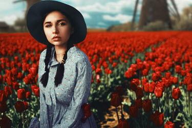 Kirill Sakryukin WOMAN IN RED TULIP FIELD