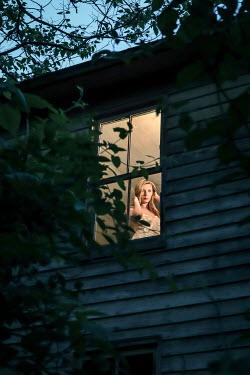 Stephen Carroll WOMAN IN NIGHTDRESS STANDING AT WINDOW Women