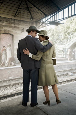 CollaborationJS 1940s COUPLE WAITING AT TRAIN STATION Couples