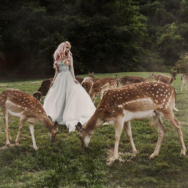 Jovana Rikalo Woman in gown wth deers Women