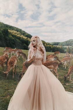 Jovana Rikalo Woman in dress with deers Women