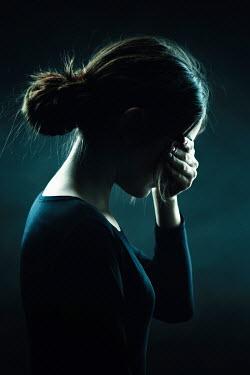 Magdalena Russocka sad teenage girl covering eyes with hand inside Children