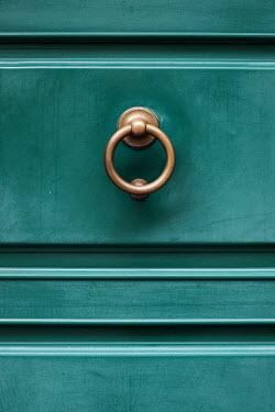 Maria Petkova metal knocker on blue door Building Detail