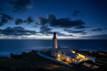 Ollie Taylor Lighthouse by the sea at night Seascapes/Beaches