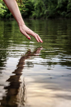 Stephen Carroll Hand touching water and reflection Body Detail