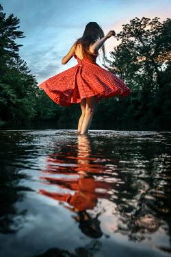 Stephen Carroll Woman dancing in lake Women