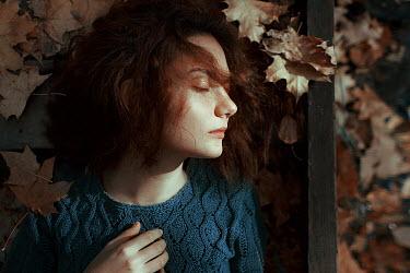 Irina Orwald Girl lying in autumn leaves Women