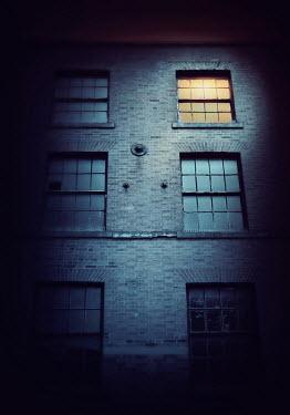 Lyn Randle Windows on three-story building Houses