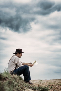 Magdalena Russocka historical cowboy reading letter in field Men