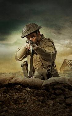 CollaborationJS A british soldier aiming his rifle at camera Men