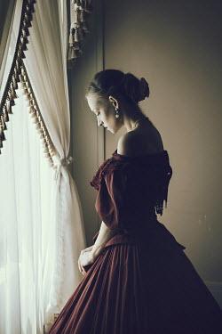 Dorota Gorecka Historical woman stood by window Women