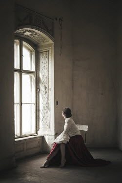 Dorota Gorecka Woman sat on chair by window Women