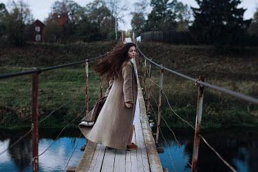 Irina Orwald Woman walking on wooden bridge Women