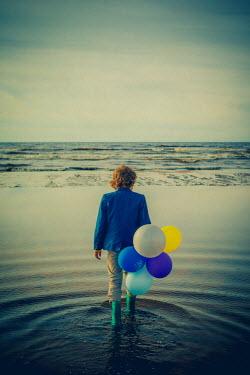 Katya Evdokimova BOY WITH BALLOONS PADDLING IN SEA Children