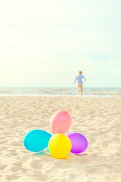 Katya Evdokimova BOY RUNNING ON BEACH WITH BALLOONS Children