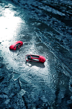 Magdalena Russocka child's red shoes in puddle