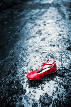 Magdalena Russocka child's red shoe in puddle