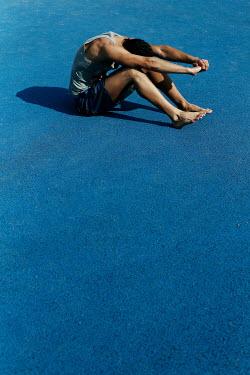 Giovan Battista D'Achille MAN SITTING AND EXERCISING ON BLUE FLOOR Men