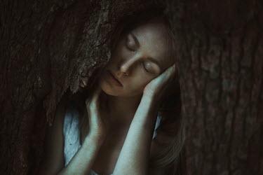Greta Larosa DREAMY WOMAN IN HOLLOW OF TREE Women