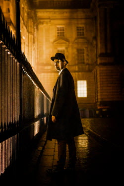 Laurence Winram MAN BY RAILINGS IN CITY AT NIGHT Men