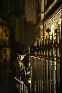 Laurence Winram MAN BY RAILINGS AT NIGHT IN CITY Men
