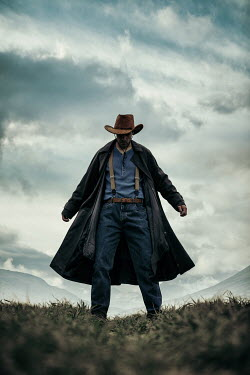 Magdalena Russocka historical cowboy man standing in field with mountains