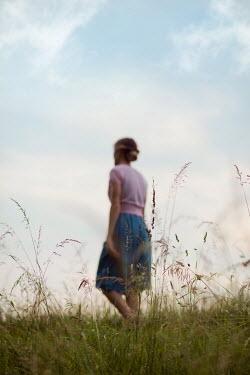 Ildiko Neer Vintage woman walking in grass
