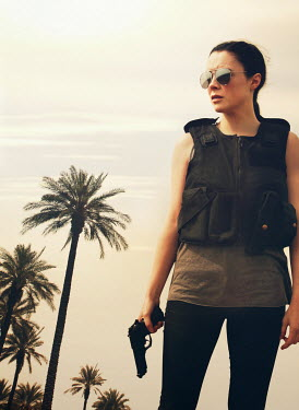 Mark Owen WOMAN IN SUNGLASSES WITH GUN BY PALM TREES Women