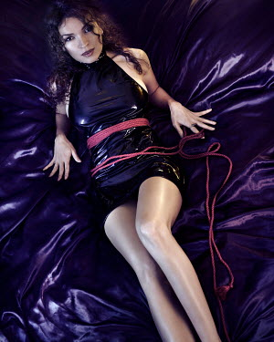 Alex Maxim WOMAN IN PVC DRESS TIED WITH ROPE ON BED Women