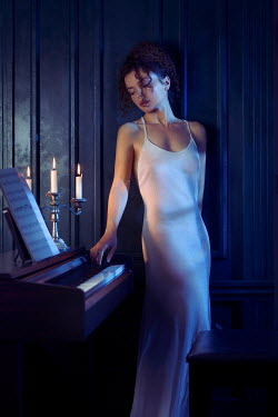 Alex Maxim WOMAN BY PIANO WITH CANDLES INDOORS Women