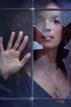 Alex Maxim WOMAN PRESSING HAND ON BROKEN WINDOW Women