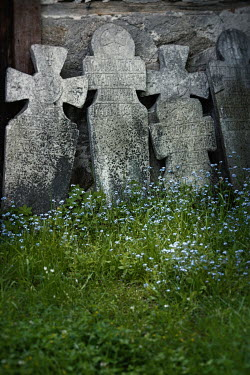 Svetlana Bekyarova LINE OF OLD HEADSTONES WITH FLOWERS Statuary/Gravestones