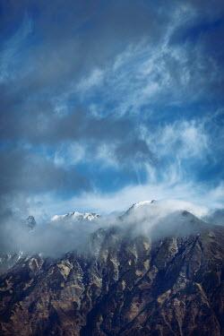 Alex Maxim mountain peak and cloudy sky Rocks/Mountains