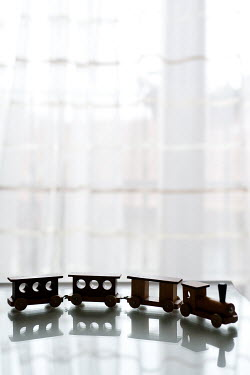 Kerstin Marinov TOY TRAIN SET ON TABLE BY WINDOW Miscellaneous Objects