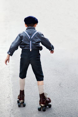 Kerstin Marinov RETRO BOY ON ROLLER SKATES FROM BEHIND Children