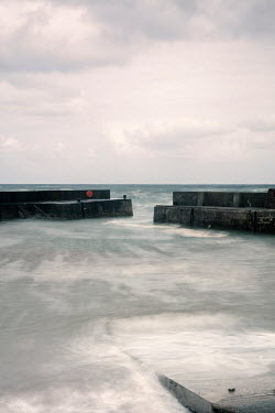David Baker SEA WITH HARBOUR WALLS Seascapes/Beaches