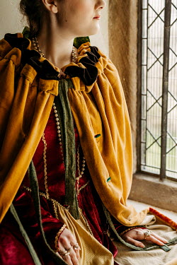 Shelley Richmond HISTORICAL WOMAN IN CAPE SITTING BY WINDOW Women