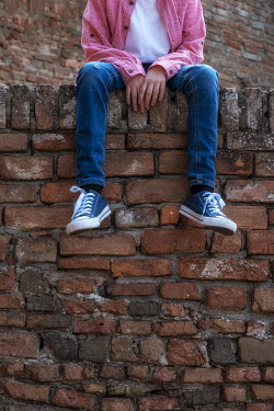 Galya Ivanova BOY IN SNEAKERS SITTING ON WALL Children