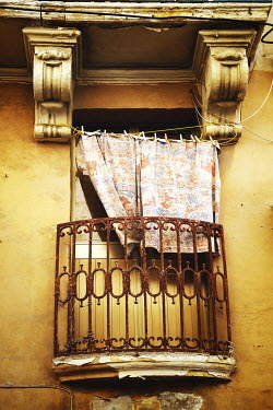 Irene Lamprakou WINDOW AND BALCONY WITH WASHING OUTSIDE OLD HOUSE Building Detail