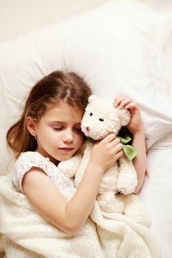 Kerstin Marinov Girl in bed with toy Children