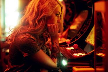 Maria Yakimova Blonde woman sat in arcade Women