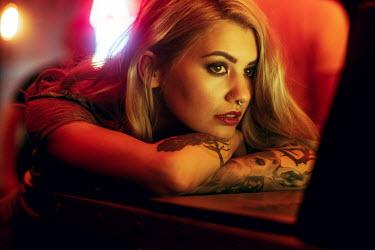 Maria Yakimova Tattooed woman watching screen Women