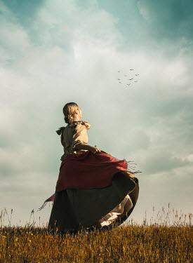 Elisabeth Ansley HISTORICAL WOMAN TWIRLING DRESS IN FIELD Women
