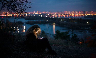 Dmitriy Bilous WOMAN WITH PHONE AT NIGHT WITH CITYSCAPE Women