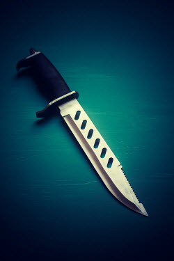 Mohamad Itani Jagged knife on blue surface Weapons
