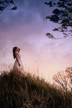 Terry Bidgood WOMAN STANDING ON GRASSY HILL Women