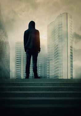 Lyn Randle Hooded man in urban landscape Men