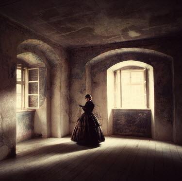 Magdalena Russocka victorian woman standing in empty room Women
