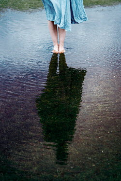 Rekha Garton WOMAN STANDING IN PUDDLE Women