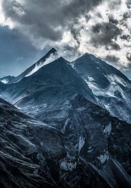 Jaroslaw Blaminsky CLOUDY SUNLIT MOUNTAIN PEAKS Rocks/Mountains